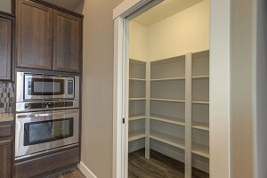 Pantry with wood shelving